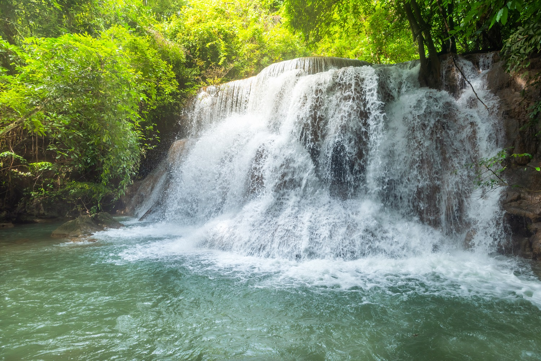 Beautiful and Breathtaking green waterfall at the tropical rainforest, Erawan's waterfall, Located Kanchanaburi Province, Thailand
