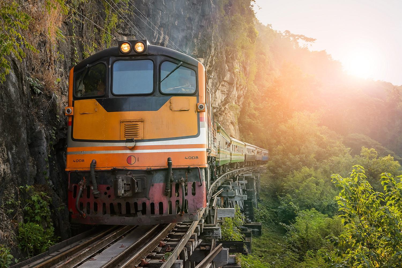 Kanchanaburi, Thailand - 12 December 2014: The train on the Bridge over the River Kwai at Kanchanaburi, Thailand. The Bridge on the River Kwai was built during World War 2.