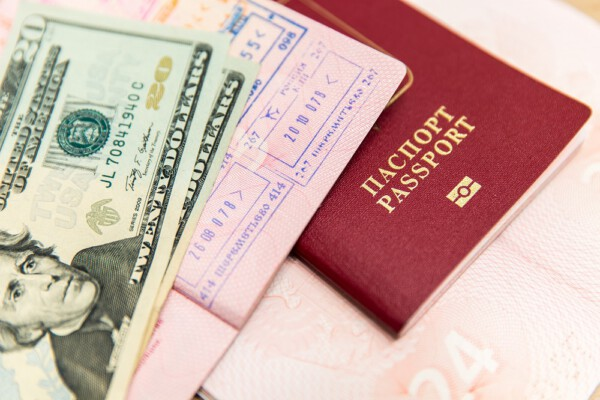 passports with dollars on top
