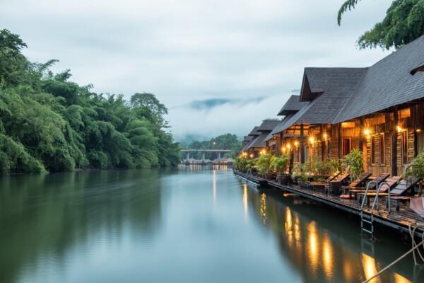 Resort wooden house floating and mountain fog on river kwai at sai yok,kanchanaburi,thailand